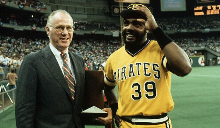 Commissioner Bowie Kuhn presents Pittsburgh's Dave Parker with the MVP award for the 1979 All-Star Game at Seattle's Kingdome.