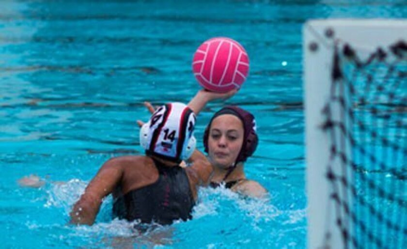 Kayleigh Schultz of The Bishop's School looks for a shot while defended by Karli Canale of La Jolla High. Ed PiPEr