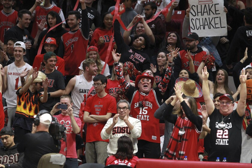 Fans cheer on the Aztecs against New Mexico at Viejas Arena last season.