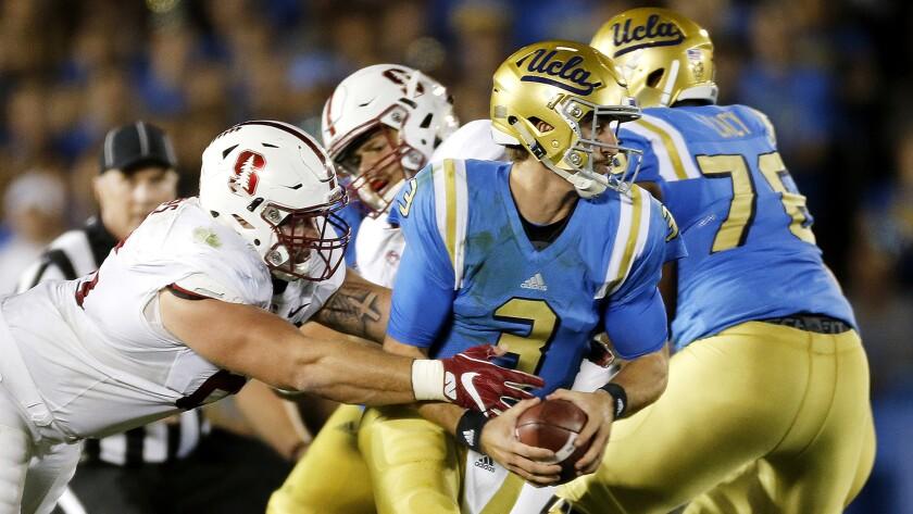 Bruins quarterback Josh Rosen has no room to operate against Stanford on Sept. 24.