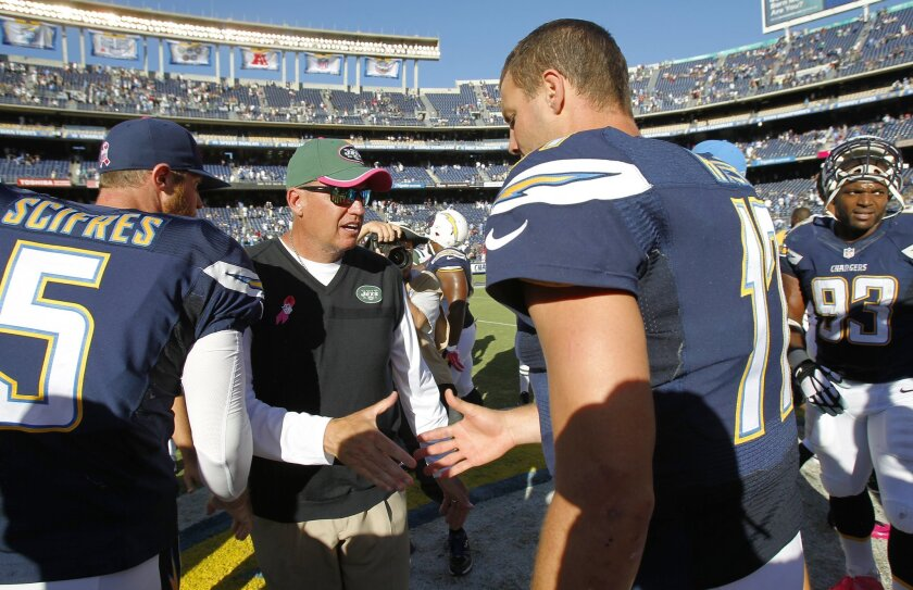 Rex Ryan greets Philip Rivers after the Chargers beat the Jets.