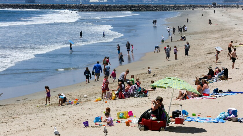 As the first days of summer approach and temperatures begin to rise, crowds head to the shoreline at Seal Beach.