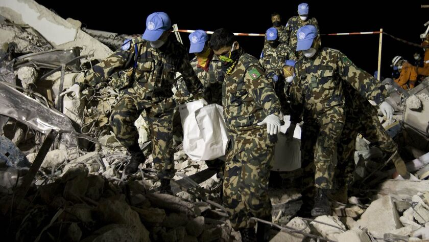 Nepalese peacekeepers from the United Nations Stabilization Mission in Haiti, MINUSTAH, help in the
