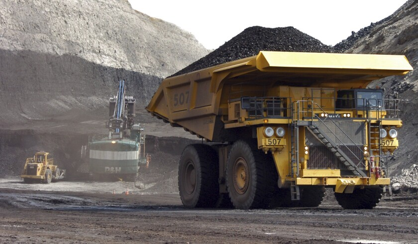 A truck carrying 250 tons of coal hauls the fuel to the surface of the Spring Creek mine near Decker, Mont., in 2013.