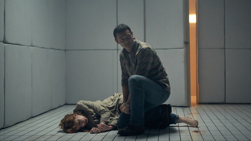 """Luke Evans and Kelly Reilly in the movie """"10x10."""""""