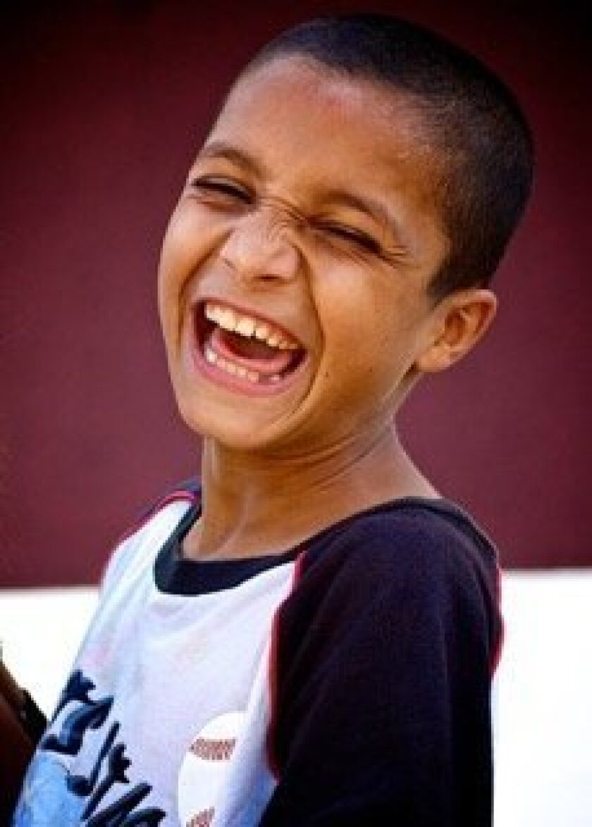 A Romanian boy smiles during a Heart To Heart event.
