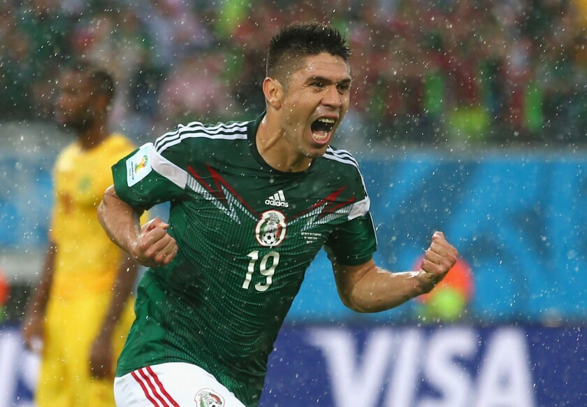 Oribe Peralta of Mexico celebrates his goal in the second half of a World Cup match Friday with Cameroon in Natal, Brazil.