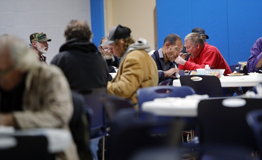 Guests eat at the annual Thanksgiving meal served at the Glendale Salvation Army on Wednesday, Nov. 27, 2019.