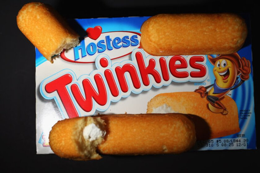 Twinkies, Ding Dongs and other Hostess snack cakes will return to shelves July 15.