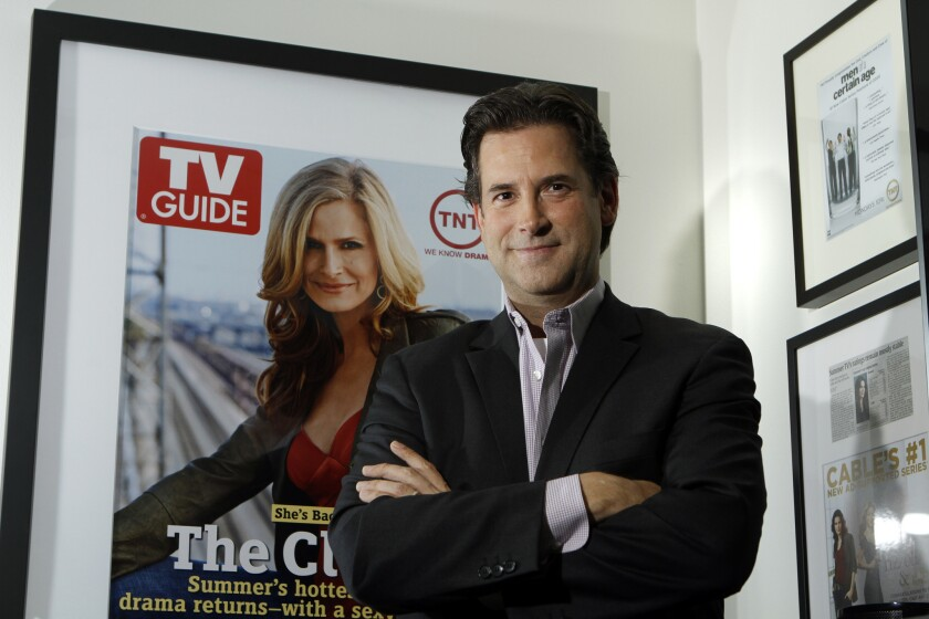 Michael Wright, programming president for Turner Broadcasting's TNT, TBS and Turner Classic Movies, is said to be stepping down. Above, Wright is shown in his Burbank office in 2010.