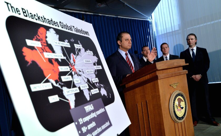 Preet Bharara, U.S. attorney for the Southern District of New York, and others at a news conference Monday.