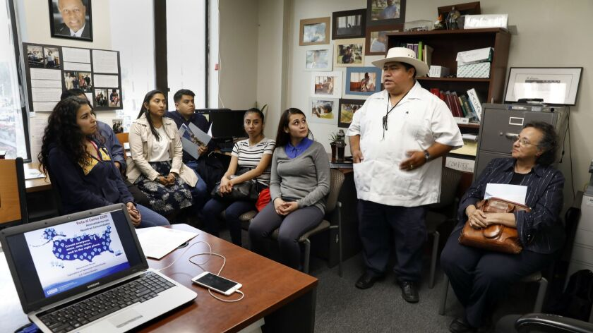 Policarpo Chaj, second from right, director of Maya Vision, speaks to a group of Mayan community members during a 2020 census meeting at Centro Cultural Techantit.