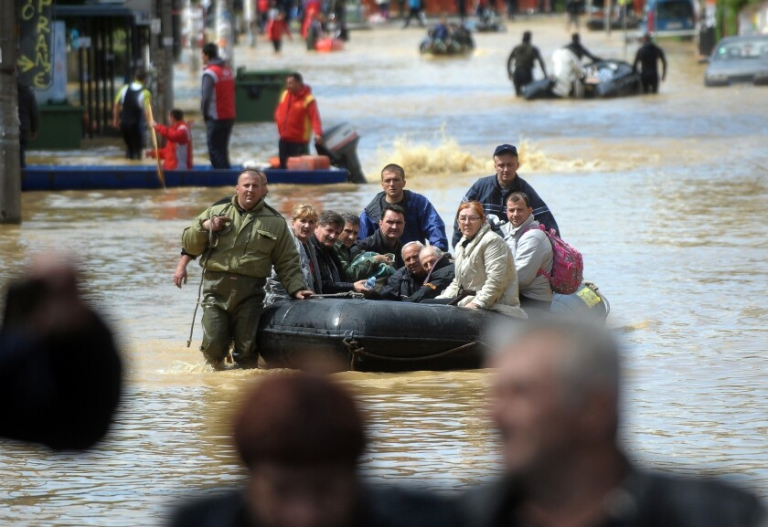 Thousands had to be evacuated from flood-ravaged Obrenovac, Serbia, after catastrophic storms in May. Rising global temperatures are contributing to an increased incidence of severe weather, the U.N.'s climate agency says.