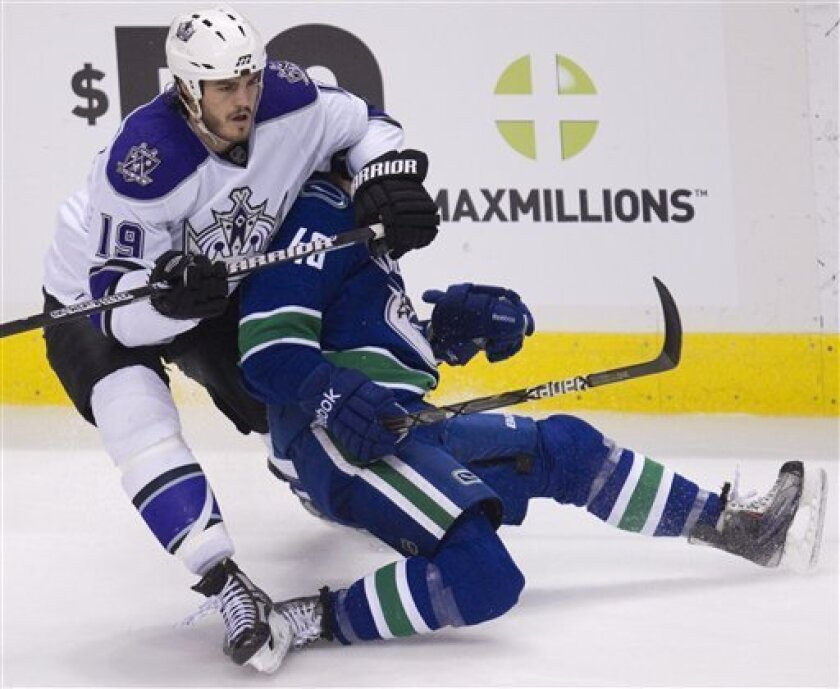 Los Angeles Kings right wing Kevin Westgarth (19) fights for control of the puck with Vancouver Canucks center Alex Bolduc (49) during second period NHL hockey action at Rogers arena in Vancouver, British Columbia, Thursday, March 31, 2011. (AP Photo/The Canadian Press, Jonathan Hayward)