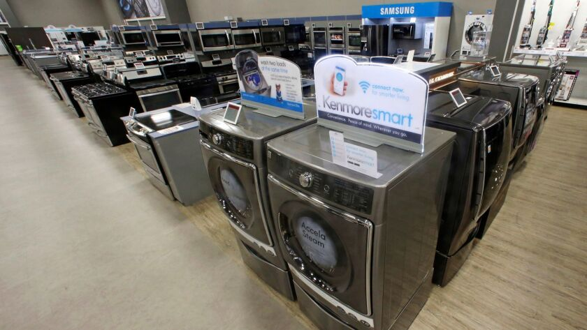 FILE - In this July 20, 2017, file photo, the Kenmore Elite Smart Electric Dryer and Front Load Wash
