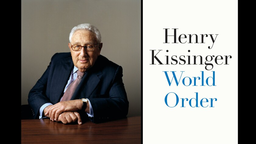 """Former Secretary of State and author Henry Kissinger and the cover of his book, """"World Order."""""""