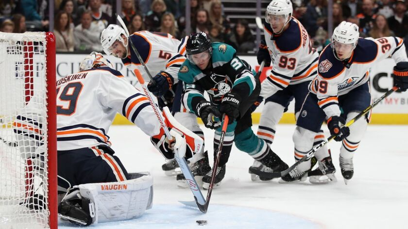 Ducks winger Jakob Silfverberg can't quite reach the puck as Oilers goalie Mikko Koskinen defends in the crease during a game Nov. 23 in Anaheim.