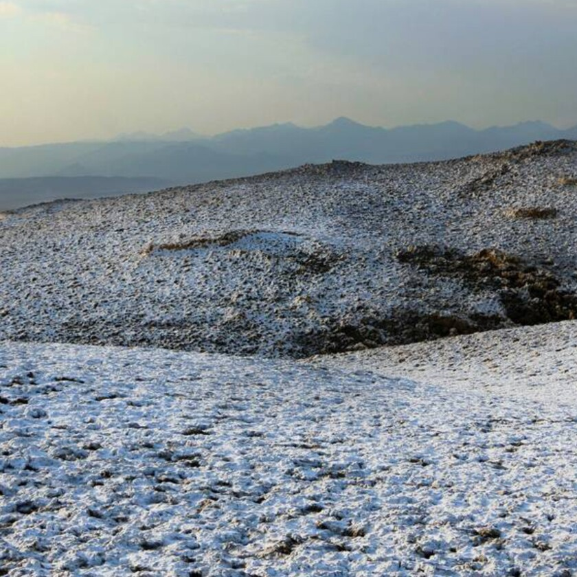 Dissolved salt and minerals resemble snow on the ground.