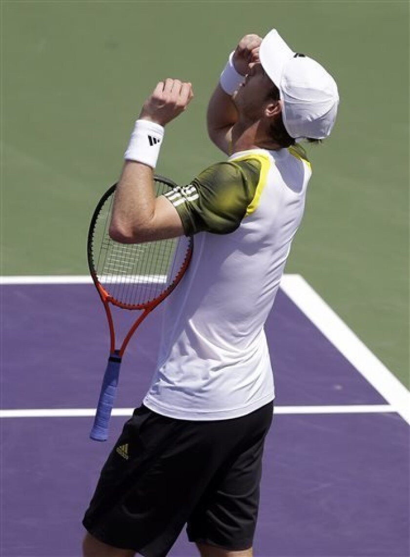 Andy Murray, of Britain, drops his racket after defeating David Ferrer, of Spain, during the final of the Sony Open tennis tournament, Sunday, March 31, 2013, in Key Biscayne, Fla. Murray won 2-6, 6-4, 7-6 (1). (AP Photo/Lynne Sladky)