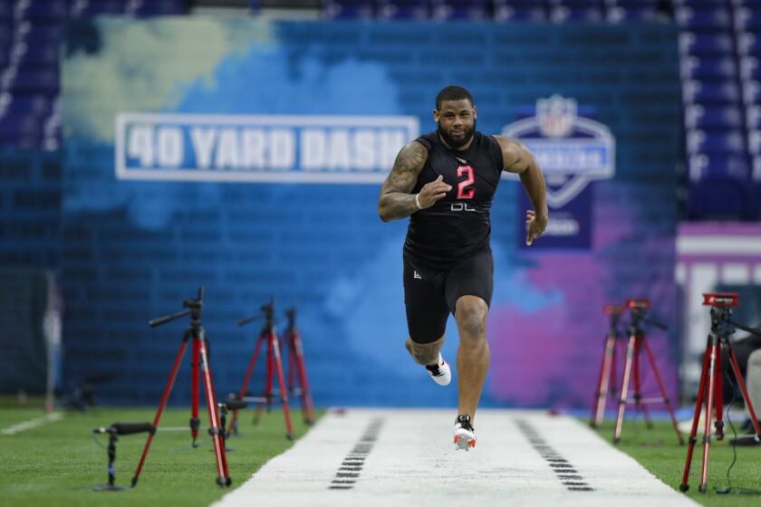 TCU defensive lineman Ross Blacklock runs the 40-yard dash at the NFL scouting combine in February.