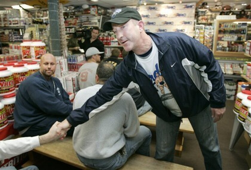 Brian McNamee, former personal trainer for baseball player Roger Clemens, greets members of the audience before speaking to a group of coaches, students and parents at a nutritional supplement store, in Everett, Mass., Thursday, March 27, 2008. In his first public comments since testifying that he injected Clemens with steroids and human growth hormone, McNamee gave about 25 high school athletes, coaches and parents a warning about mistakes that can tarnish one's reputation. (AP Photo/Steven Senne)
