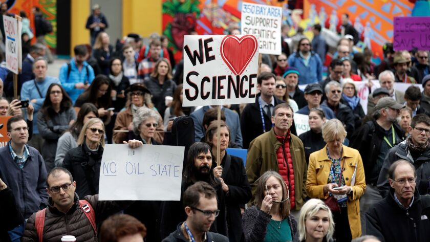 Hundreds of scientists protest during a December meeting of the American Geophysical Union in San Francisco to denounce Donald Trump's position on climate change.