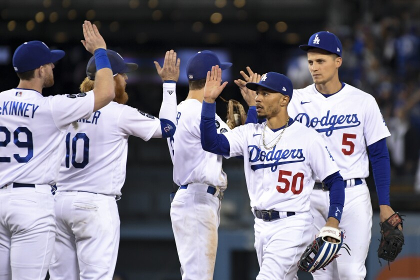 Dodgers right fielder Mookie Betts and shortstop Corey Seager celebrate with their teammates.