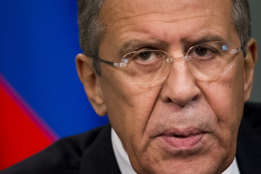 Russian Foreign Minister Sergey Lavrov speaks to the media during a news conference with Syria's Foreign Minister Walid al-Moallem following their talks in Moscow, Russia, Friday, Nov. 27, 2015. The presidents of France and Russia agreed Thursday, Nov. 26, 2015 to tighten cooperation in the fight against the Islamic State group, although they remained at odds over their approach toward Syrian President Bashar Assad. (AP Photo/Ivan Sekretarev)