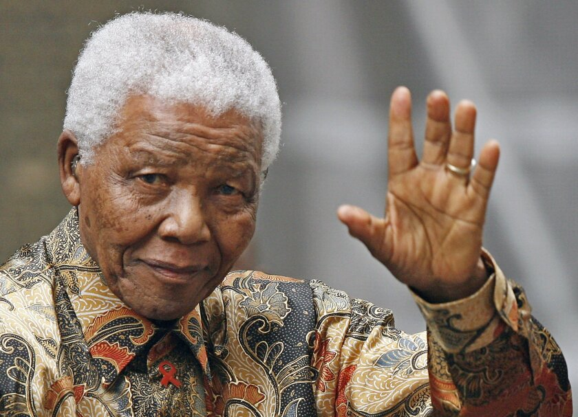 Nelson Mandela is seen waving to the media while in London in 2007.