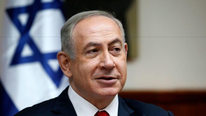 Israeli Prime Minister Benjamin Netanyahu attends the weekly cabinet meeting in Jerusalem on Sunday.