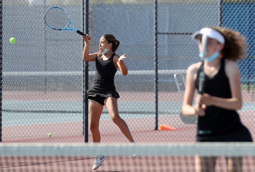 Kana Byrd, left, is shown competing in doubles for the Sage Hill School girls' tennis team last spring.