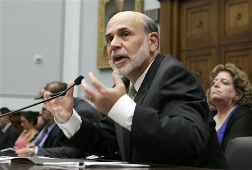 Federal Reserve Chairman Ben Bernanke testifies on Capitol Hill in Washington, Wednesday, July 13, 2011, before the House Financial Services Committee where he delivered the semiannual Monetary Policy Report. (AP Photo/Carolyn Kaster)