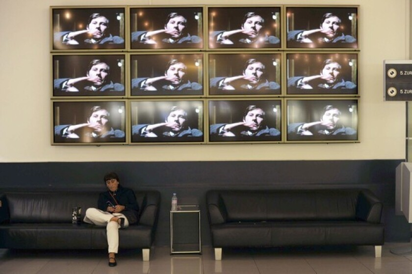 Film director Roman Polanski is shown on a wall of TV screens at the Zurich Film Festival, where he was headed when Swiss officials arrested him at the request of L.A. County prosecutors.