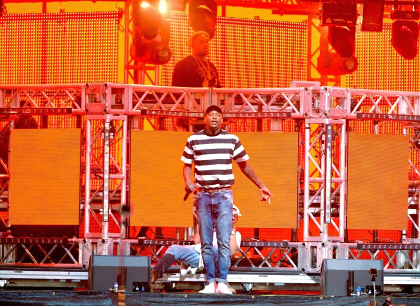 DJ Mustard (back) and hip-hop artist YG perform onstage during day 1 of the 2016 Coachella Valley Music & Arts Festival Weekend 1 at the Empire Polo Club on April 15, 2016 in Indio.