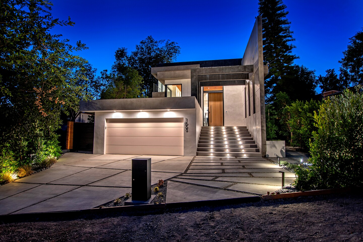 The newly built Silver Lake home, listed for $3.599 million, stands out from the street with its subdued hues, clean lines and modern arcade that tops the entry. Inside, the open-concept floor plan turns the page with French oak floors and white walls that brighten the interior. Leathered quartz countertops create visual interest in the kitchen, which has an island and bi-folding doors that open to the patio. Outside, there's a swimming pool and spa. A rooftop deck creates an additional 1,500 square feet of living space above.