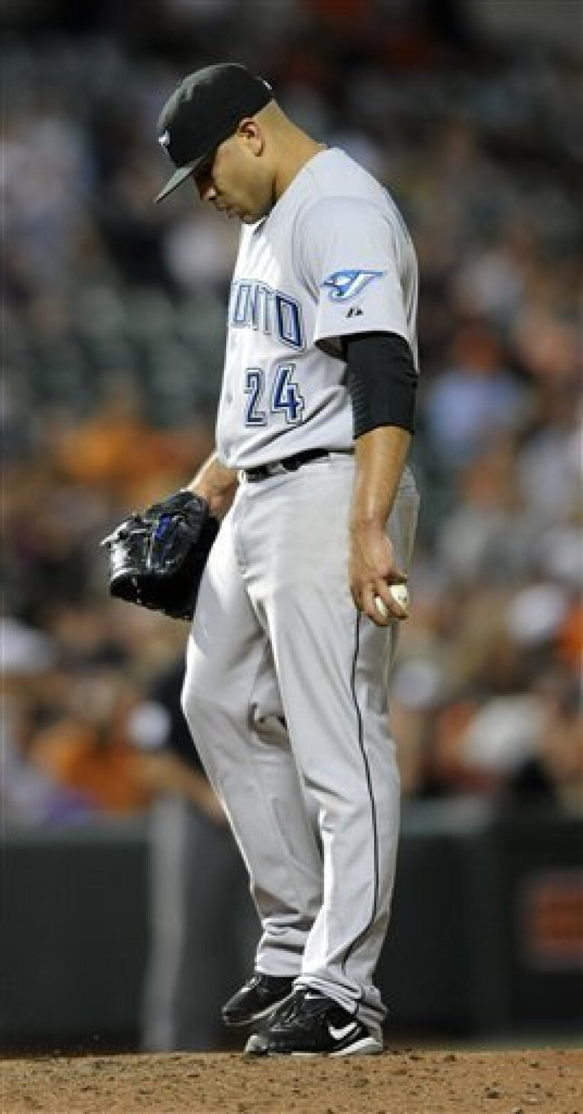 Toronto Blue Jays pitcher Ricky Romero reacts after giving up a grand slam to the Baltimore Orioles in the sixth inning of a baseball game, Saturday, June 4, 2011, in Baltimore. The Orioles won 5-3. (AP Photo/Gail Burton)