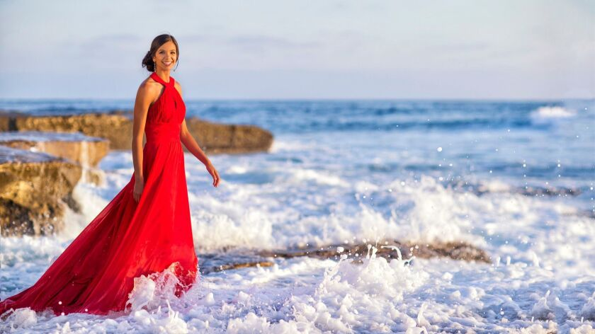 Jayce Gorzeman plays with the waves during her photo session.