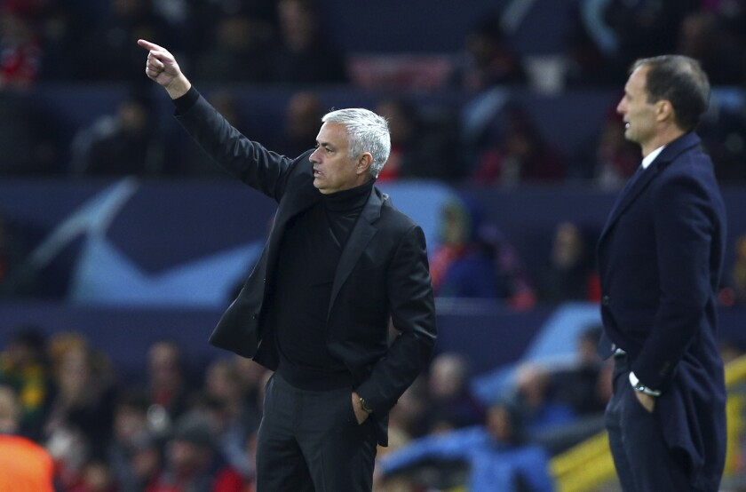 FILE - In this Oct. 23, 2018 file photo, ManU coach Jose Mourinho, left, gestures next to Juventus coach Massimiliano Allegri during the Champions League group H soccer match between Manchester United and Juventus at Old Trafford, Manchester, England. There's never been any love lost between Jose Mourinho and Massimiliano Allegri. The rivalry resumes on Sunday, Oct. 17, 2021 when Mourinho's Roma visits Allegri's Juventus in a pivotal game for both clubs. (AP Photo/Dave Thompson, file)