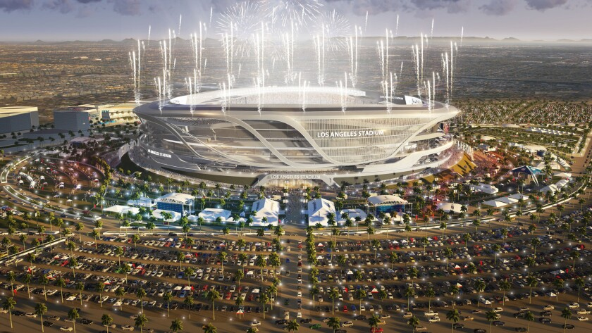 A look at the proposed $1.7-billion stadium in Carson lit up at night. It could be home to the Chargers and Raiders in the near future.