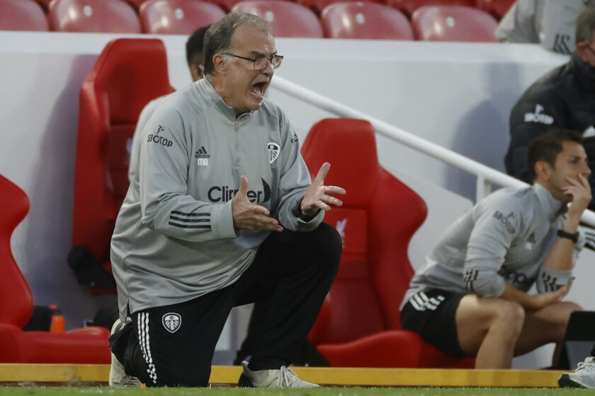 Leeds United's head coach Marcelo Bielsa calls out to his players during the English Premier League soccer match between Liverpool and Leeds United, at the Anfield stadium, in Liverpool, Saturday, Sept. 12, 2020. (Phil Noble, Pool via AP)