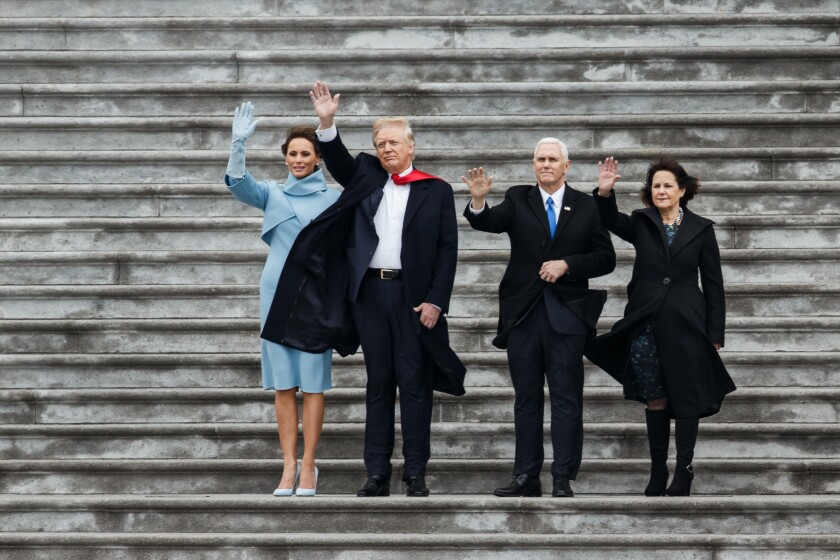 President Trump, Vice President Mike Pence and their spouses wave to the helicopter carrying former President Obama and the first family.