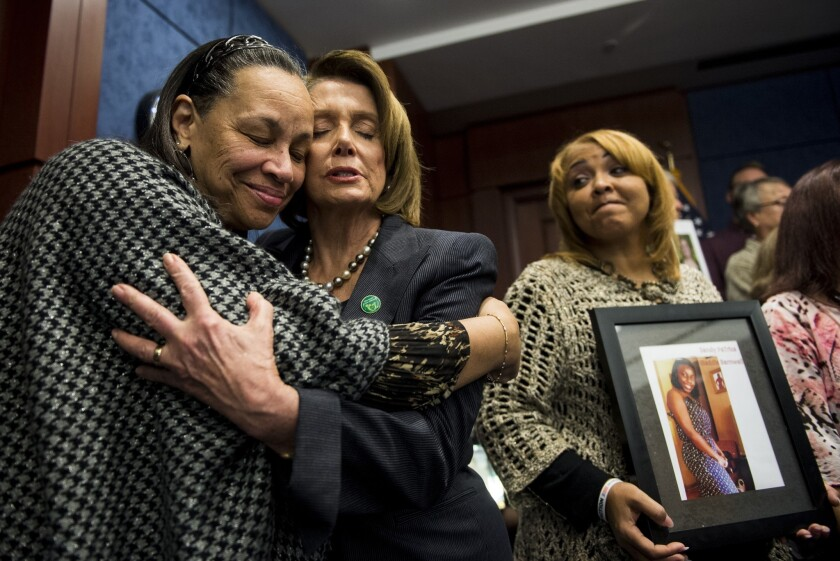 Nancy Pelosi embraces family members of gun violence victims