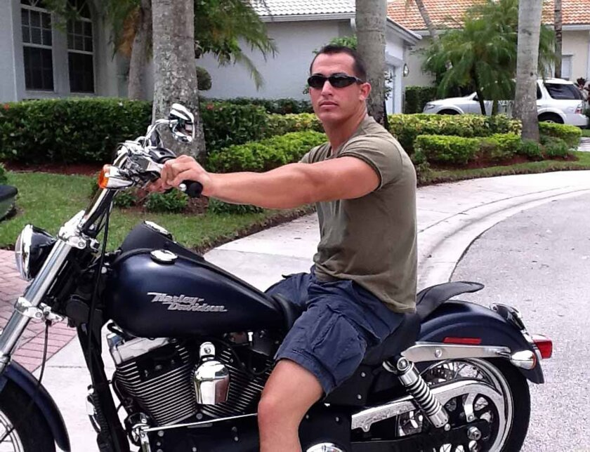 Marine Sgt. Andrew Tahmooressi sits astride a Harley Davidson during a 2011 visit to his home in Florida. He is currently in a Mexican prison on weapons charges, awaiting a July 9 hearing.