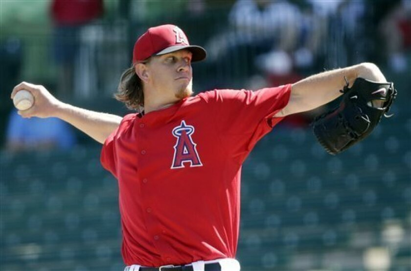 Los Angeles Angels' Jered Weaver throws during the first inning of an exhibition baseball game against Italy on Wednesday, March 6, 2013, in Tempe, Ariz. (AP Photo/Morry Gash)