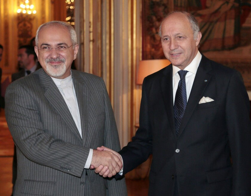 French Foreign Minister Laurent Fabius, right, welcomes Iranian Foreign Minister Mohammad Javad Zarif in Paris. Zarif will take part in talks in Geneva this week with representatives of six world powers, which are seeking curbs on Iran's nuclear program.