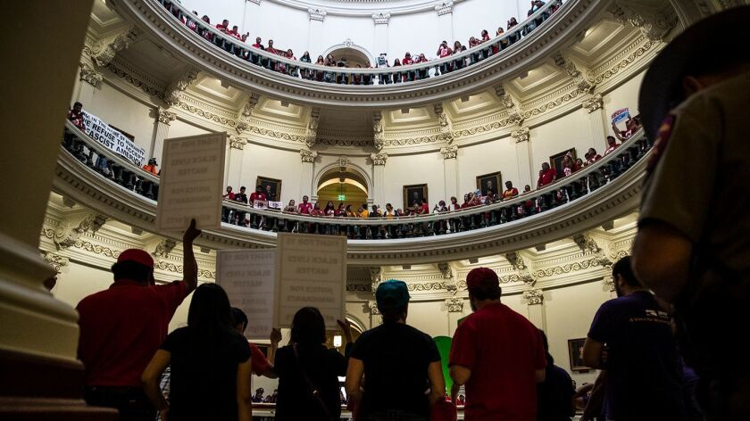 Hundreds of protesters line the balconies of the state Capitol rotunda in Austin on Monday, May 29,