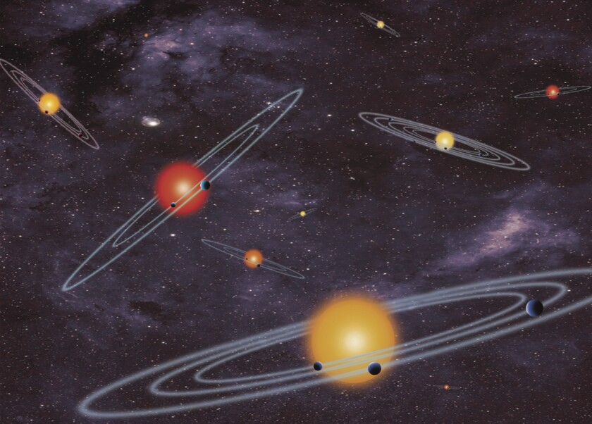 This artist's illustration shows stars with multiple planets transiting in front of them. Data form NASA's Kepler Space Telescope has revealed 715 confirmed planets among the 3,601 candidate planets the spacecraft discovered.