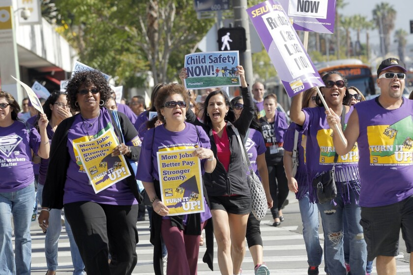 Service Employees International Union members rally for higher wages in downtown Los Angeles in October.
