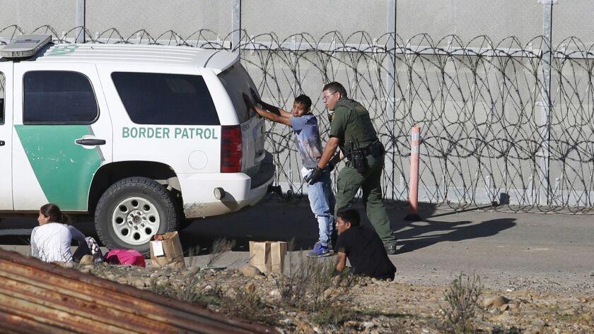Honduran asylum seekers are taken into custody by U.S. Border Patrol