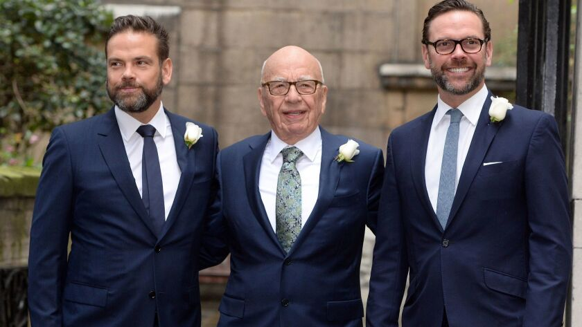 Rupert Murdoch, center, poses with sons Lachlan, left, and James in London in 2016.